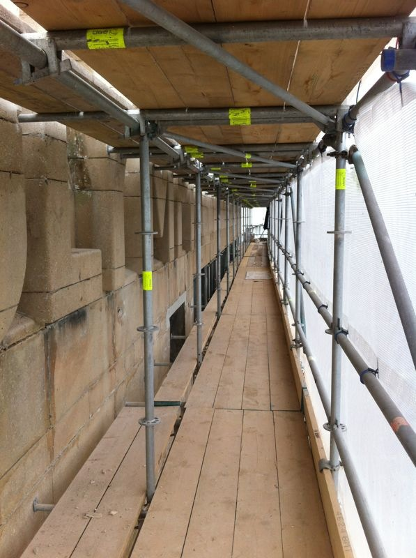 Scaffolding. Stone restoration at height.