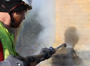 Close up of war memorial cleaning